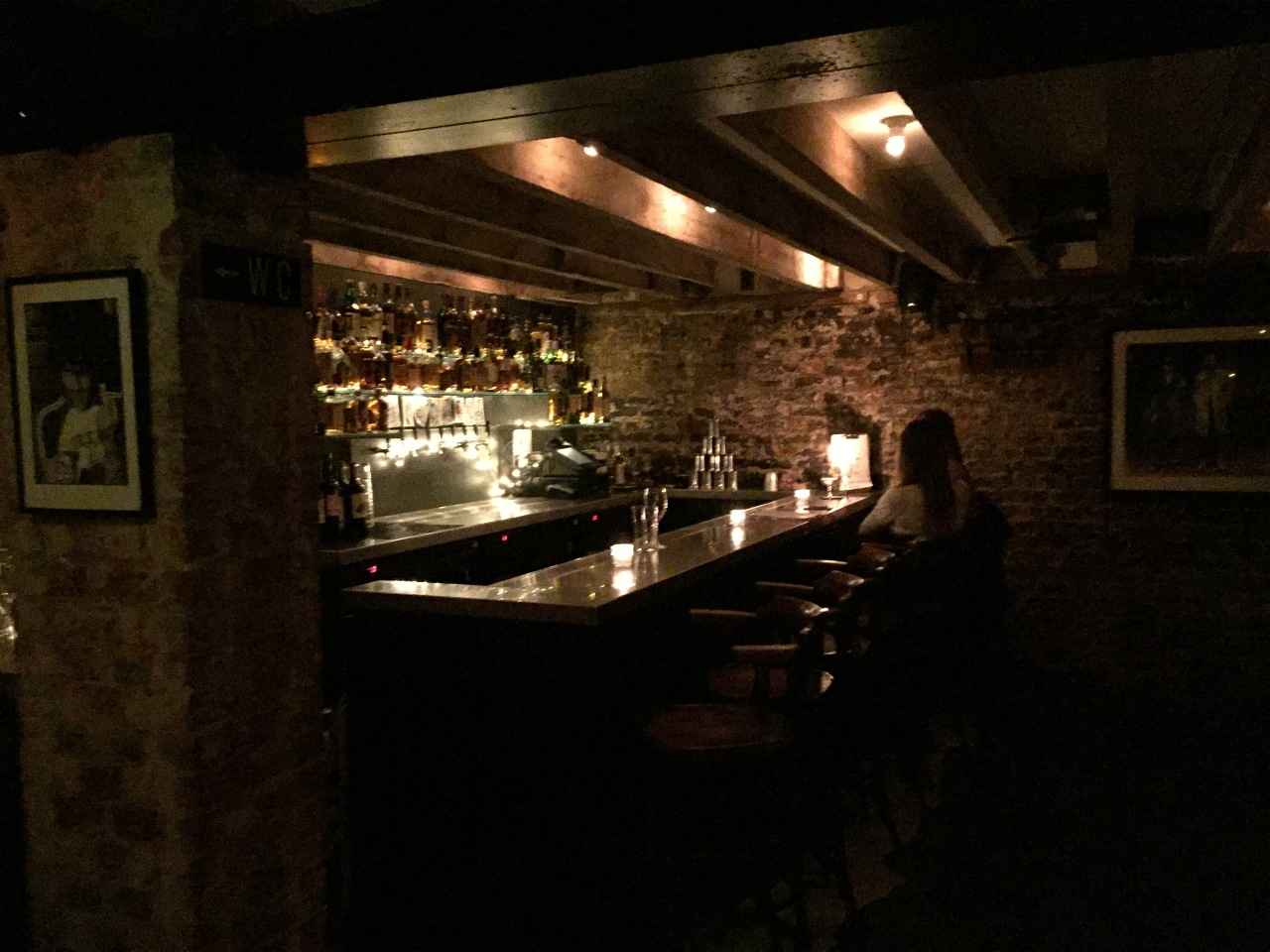 A candlelit bar in the basement of The Gallery